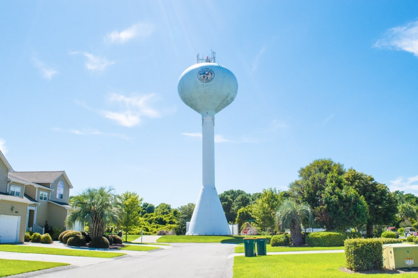 Pictured Above: One of two water towers in Kure Beach. The Town Council discussed the reasoning behind the high cost  of irrigation meters during their July 18th, meeting. A meter cost $4,000.00 and the high price is designed to promote conservation rather than increased irrigation using treated drinking water from underground aquifers.