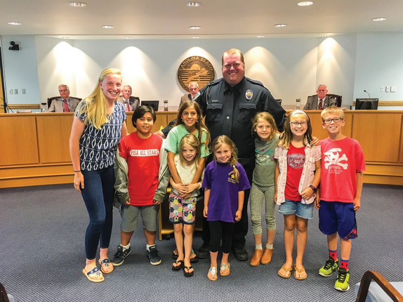 Carolina Beach Police Officer Stewart Henderson was recognized by the Town Council during their Monday May 9th, meeting for his ten years of service to the community. Henderson serves as the School Resource Officer at Carolina Beach Elementary School and is well known and respected by students, parents and teachers.