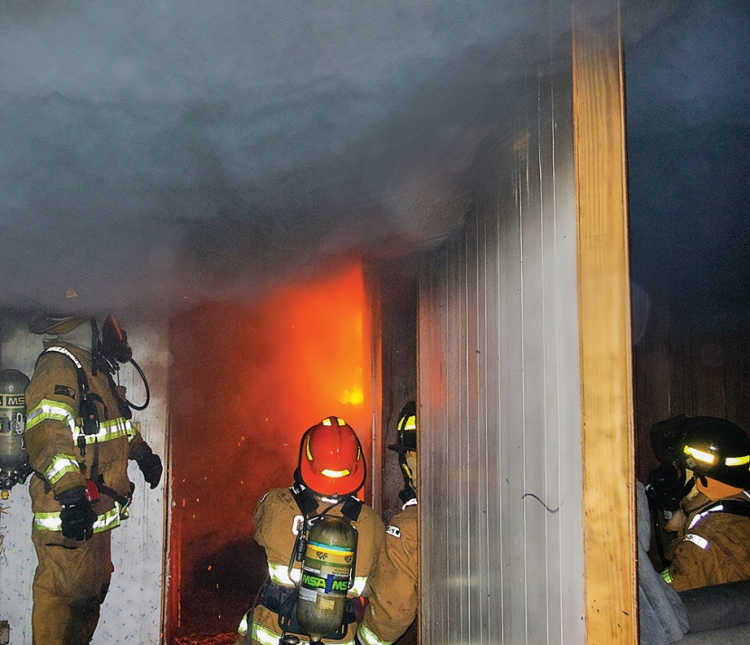 The Carolina Beach Fire Department will conduct training exercises at a house at 1517 Snapper Lane on February 18th. Firefighters will have an opportunity to conduct live fire training in individual rooms.  The building will not be entirely burned. (Photo from previous training exercise).
