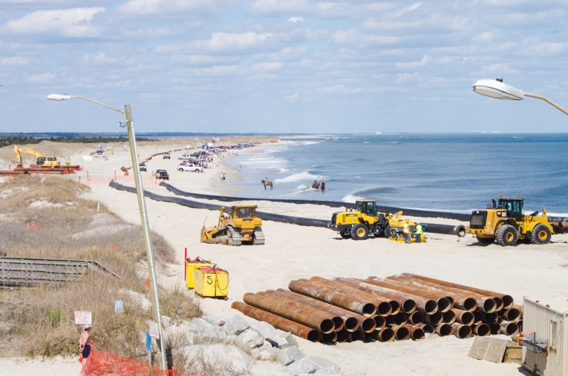 Crews have begun installing pipes that will be used to pump sand from the Carolina Beach Inlet south to Carolina Beach to pump sand onto the beach front from the Carolina Beach Fishing Pier south to the Boardwalk area.
