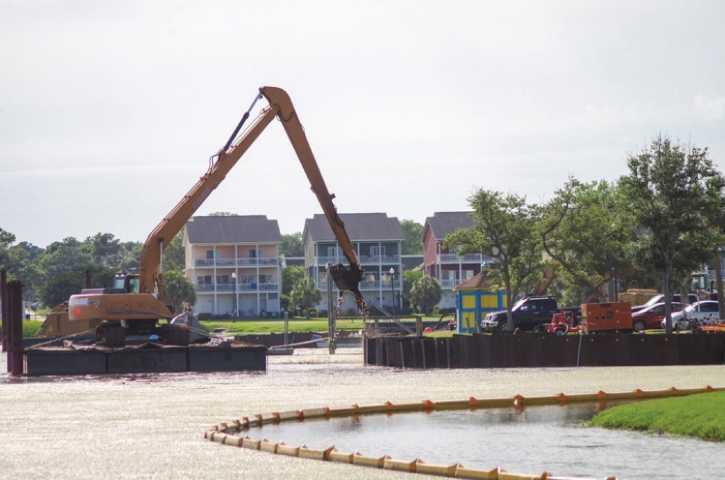 A $2.7 million dollar project to dredge the Carolina Beach Lake to hold additional storm water runoff began in 2017. On August 29th, the U.S. Army demanded the Town stop hauling dirt to land leased to the Town since the 1970's for a wastewater treatment plant off Dow Road.  The Town was placing the dirt at an unapproved location on the property. Now the Town is searching for alternate locations. (Photo: Summer of 2017).