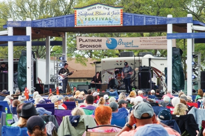 "The Pleasure Island Chamber of Commerce held their 25th Annual Seafood, Blues and Jazz Festival  on April 13th and 14th. Originally set for Oct. 13th-14th, 2018 at the Ft. Fisher Air Force Recreation Area in Kure Beach, North Carolina, due to Hurricane Florence, the festival was rescheduled to  April. The festival was billed as ""The Year of the Woman"" featuring International Blues Recording Artist Ana Popovic, Kansas City's Danielle Nicole and the incredible Heather Gillis Band. Despite rain on Saturday, crowds braved the weather and all bands took the stage.  The rain stopped late Saturday and the sun shined on Sunday."