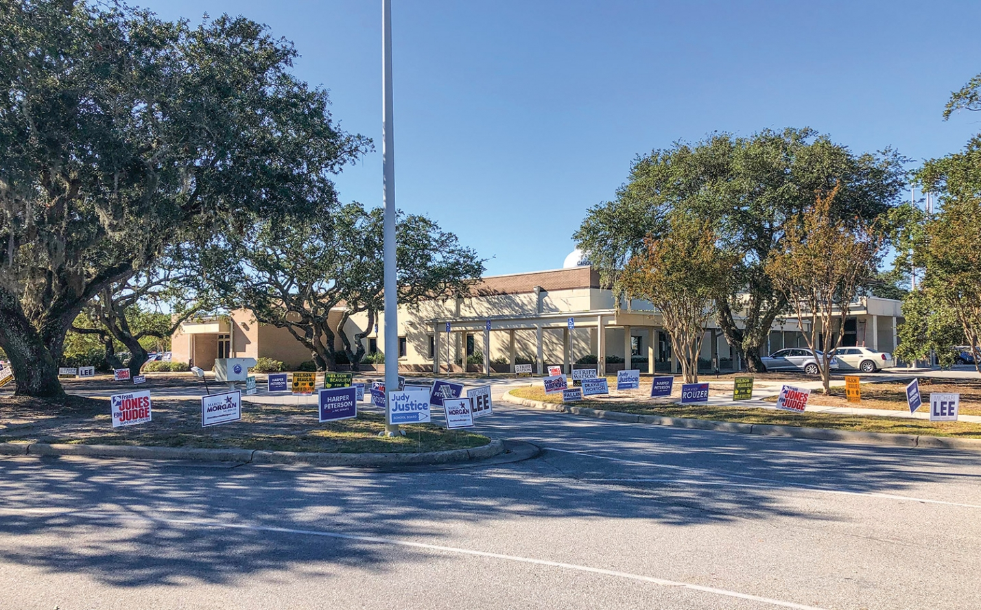 Election Day is November 6th, but you can vote early at a number of polling locations throughout New Hanover County. (Pictured Above:) Signs placed at the entrance to the polling location at the Carolina Beach Town Hall on Tuesday afternoon October 30th.  Early voting began October 17th, and will continue through Saturday November 3rd.