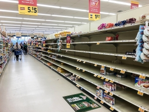 Sunday afternoon at the Food Lion in Carolina Beach. The shelves were emptied of bread, toilet paper,  paper towels and many other items. Like many other area stores, fresh chicken and beef were either in short supply or unavailable due to people rushing to stock their home freezers. Many stores continue to stock up the following day.