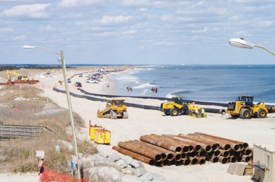 (Pictured Above: Beach Nourishment Project at Carolina Beach in 2016. Pipes located within Freeman Park). The Carolina Beach Town Council voted Friday August 3rd, to obtain easements across properties within Freeman Park on the North End of Pleasure Island to protect an upcoming project to renourish the beach in the Spring of 2019. The Town will use eminent domain to obtain the easements.