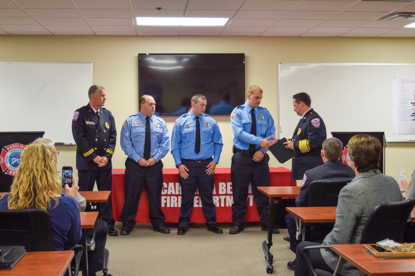 The Carolina Beach Fire Department held their annual service awards banquet Monday April 9th. (Pictured above: Right to left:) Fire Chief Alan Griffin awarding fire fighters John Bard, Dakota Griffin, Josh Canfield and Ken Athing with the  Meritorious Unit Citation for their efforts at a October 2017 water rescue call.