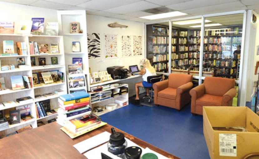 "Island Book Shop is located at 100 North Lake Park Boulevard, Suite 1, in Carolina Beach. Just between Beach Blooms and the Dive.  For more information, call Island Book Shop at (910) 707-0504. You can also become a friend of the Island Book Shop on www.facebook.com and receive their  entertaining ""Quotes of the Day"" as well as having access to the most up to date information about everything that is happening at the Island Book Shop."