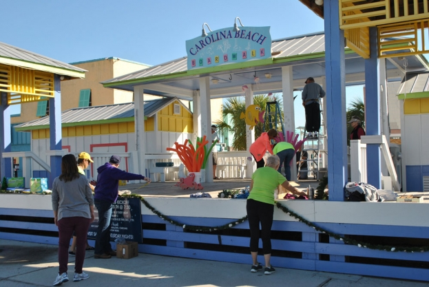 Last week ladies with the Island Women group decorated the Carolina Beach Boardwalk Gazebo in  preparation for Christmas By The Sea. This year's theme is Finding Dory, events kick-off this Friday! Island Women is a  community action organization of women interested in improving the amenities that Pleasure Island has to offer.  As a diverse group of localwomen with many talents and resources at hand, our objective is to improve the quality of life on Pleasure Island for our residents. Fore more information follow the Island Women on facebook or visit www.islandwomen.org