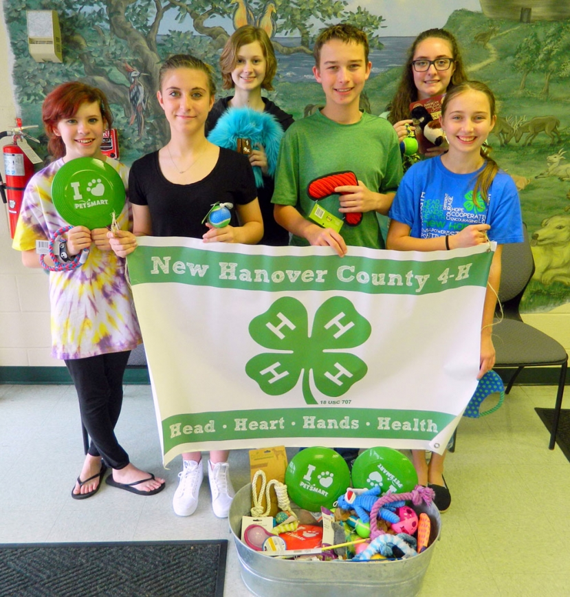 (Pictured Above): (L-R): Elizabeth Fillman, Samantha Sharpe, Ashley Reece, Aidan Shepard, Liz Sharpe, and Cate Shepard presented pet toys to the New Hanover County Animal Services Unit.Date: April 20, 2016