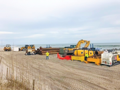 Equipment was delivered earlier this week to the beach front on the North End of Pleasure Island. A project to pump sand on to the beach front in Carolina Beach and Kure Beach is preparing to begin. Pumping will start in Carolina Beach and then work will proceed south to Kure Beach.
