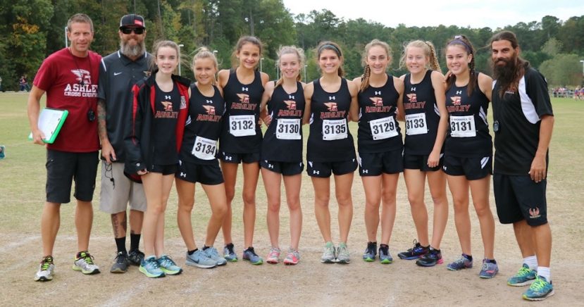 The 1st ever Girl's Cross Country Team at Ashley High School to qualifiy for the State Championship Meet. (L-R): Coach Duke Hagestrom, Coach Peyton Chitty, Leah Ager, Dani Mark, Angelina DilBlasi, Paxton Chitty, Maddy Marricinni, Grace Benfield, Emma Holton, Bianca Copeman and Head Coach Shawn McKee.
