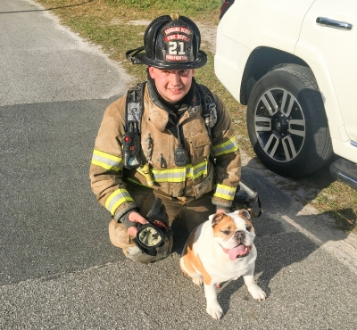 Carolina Beach Firefighter Dakota Griffin with Rocco after Rocco was rescued from a Greenville Avenue house fire earlier this afternoon in Carolina Beach.