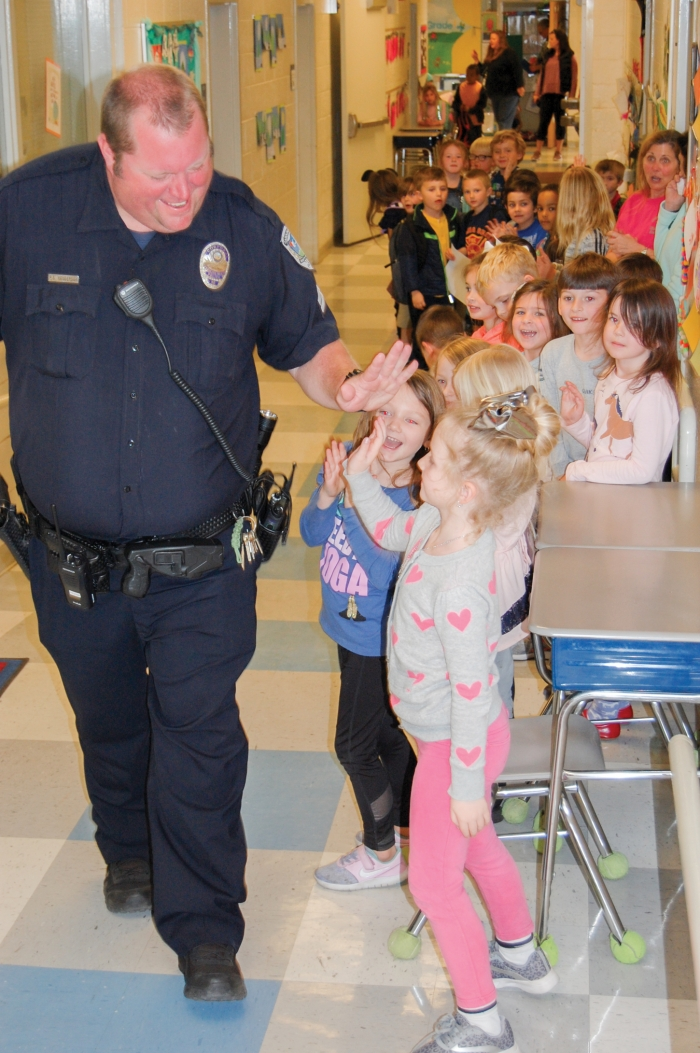 After many years serving as School Resource Officer (SRO) at Carolina Beach Elementary School, Police Officer Stewart Henderson resigned  recently to go to work for the Sheriff's Department.  On his last day at the school on February 15th, Henderson was honored by the students. He will now serve as an SRO with the Sheriff's Dept.